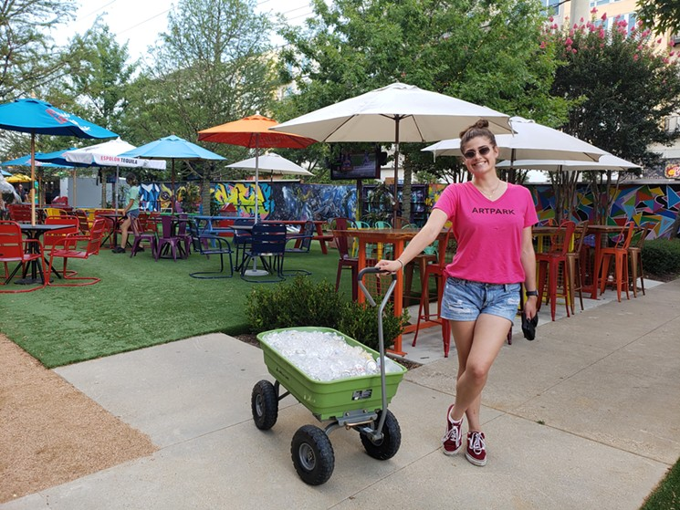 A drink wagon pulled by a happy employee. - KRISTINA ROWE