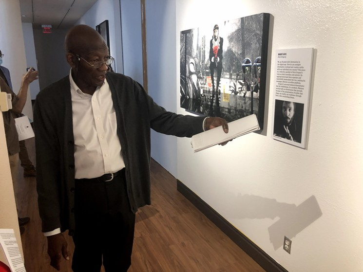 Phillip Collins, the guest curator of the Smithsonian's Men of Change exhibit and the vice-chairman of the Dallas Arts and Culture Advisory Commission, takes guests through the artworks celebrating the influences and changes made by African American Men at the African American Museum of Dallas. - DANNY GALLAGHER