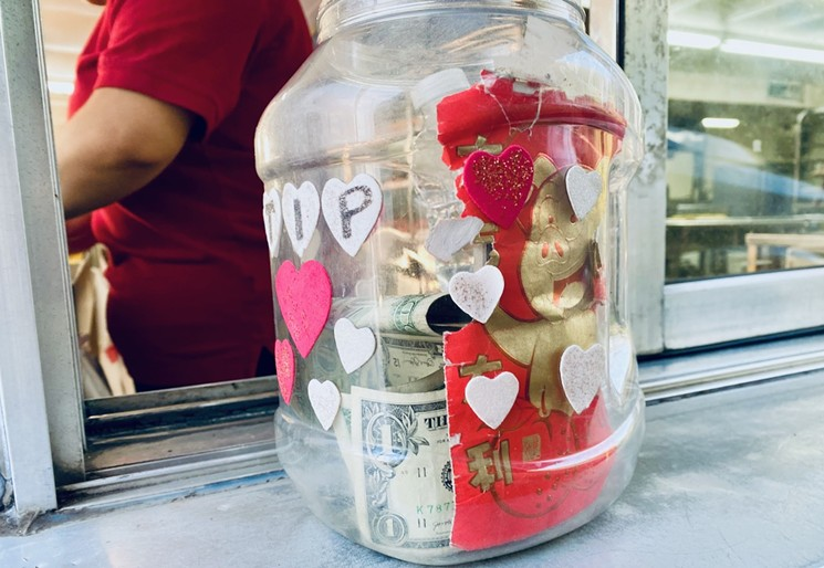 Felt hearts glued to a repurposed jug along with other personable bling is the less-aggressive ask. - LAUREN DREWES DANIELS