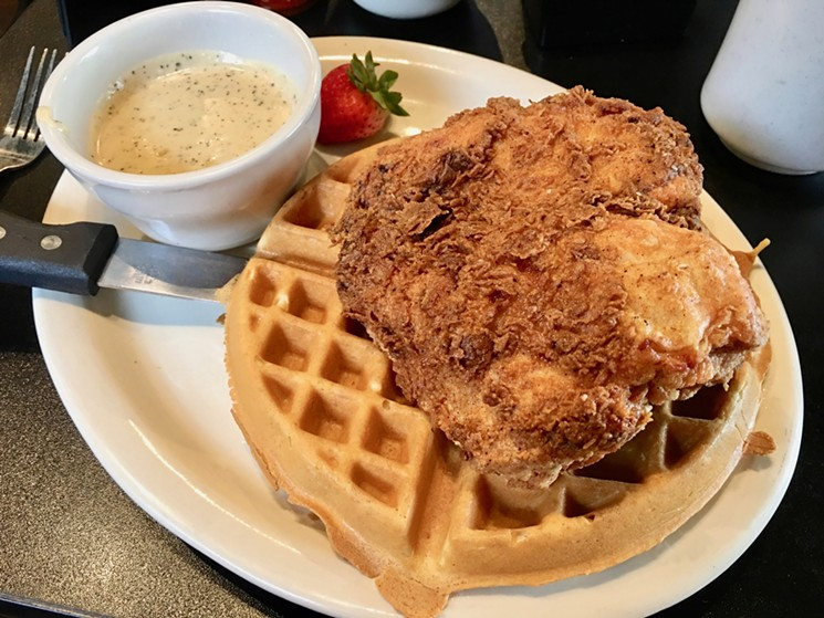 The famous chicken and waffles at Jonathon's next to the gravy, which should be equally famous. - TAYLOR ADAMS