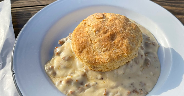 A biscuit with gravy at Bonton Market - TAYLOR ADAMS