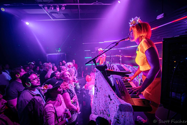 Poppy Xander playing with Helium Queens with their signature black lights and neon attire. - SCOTT FISCHER