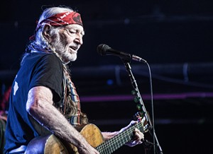 Willie Nelson playing at Billy Bob's Texas in Fort Worth, a frequent tour spot for the country icon. - MIKE BROOKS