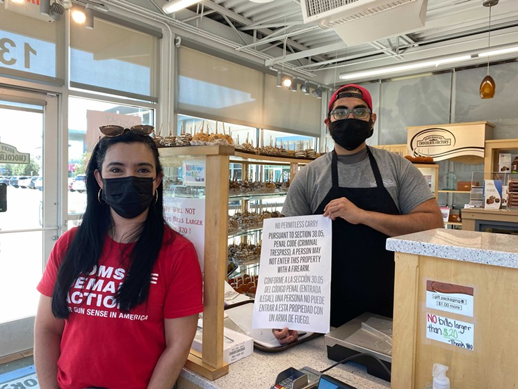 Moms Demand Action volunteers are equipping business owners with signs prohibiting firearms. - COURTESY MOMS DEMAND ACTION