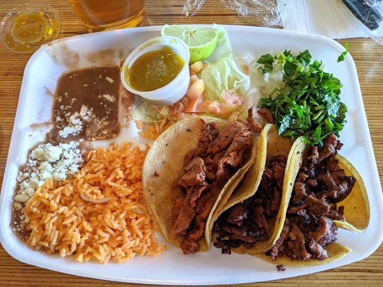 A plate of beef fajita tacos from Tacos La Gloria, served on its opening weekend at Oak Cliff Brewing Co. - BRIAN REINHART