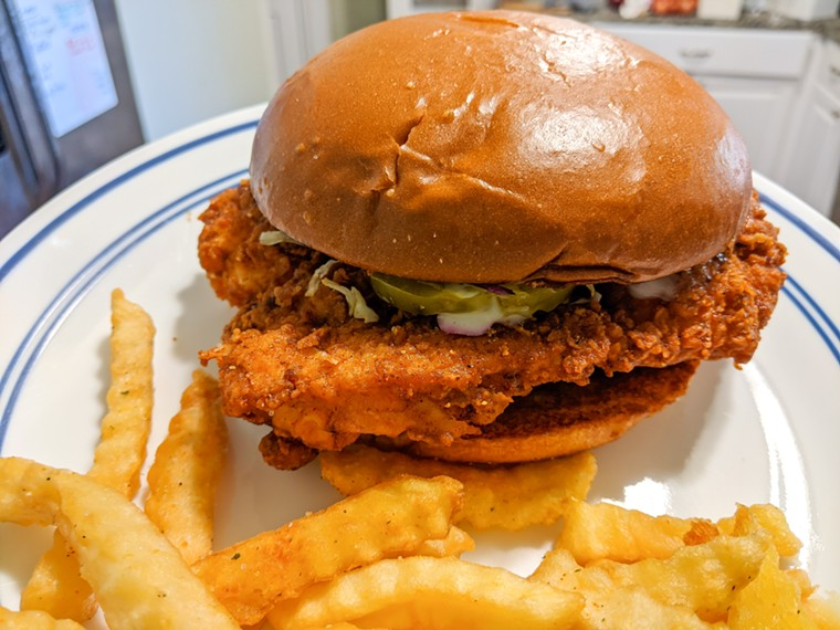 A takeout chicken sandwich, plated at home, from 2 Neighbors, in DeSoto - BRIAN REINHART