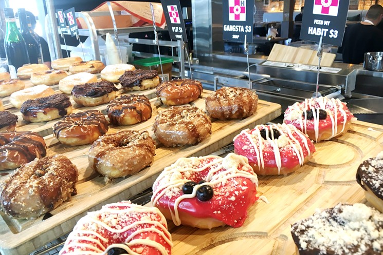 Monthly specials and habit classics fill the donut shelves.  - MARK ANTONATION