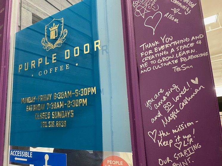 The front door of Purple Door Cafe, covered in notes of love, sits in the small warehouse of Purple Door coffee. - KRISTIN PAZULSKI