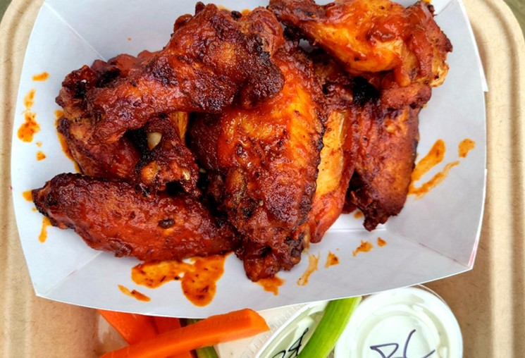 Even to-go, the wings from Smok hold up in texture and flavor. - LINNEA COVINGTON