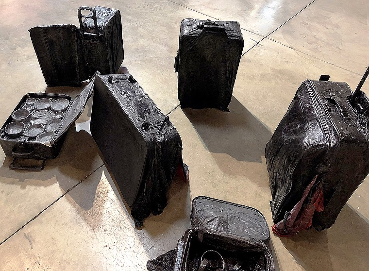 """Sammy Lee, """"FOB Arrived,"""" ongoing series since 2017, eleven various sized suitcases, hanji (Korean mulberry paper), acrylic varnish. - SAMMY LEE,"""