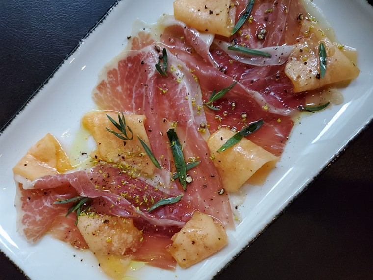 Jamon with local cantaloupe is one example of the seasonal cuisine you can sample at Sunday Vinyl. - MOLLY MARTIN