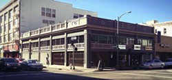 Exterior of Woods Bar & Brewery (via Facebook).