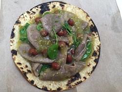 Lengua taco with tomatillo and serrano salsa and pea greens. - LEÓN