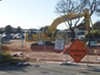A contaminated work site is across the street from the island's only child development center.
