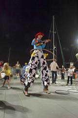 A hula-hooping stiltwalker at Jack's Night Market.