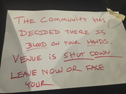 A note left by Gallagher on Vinyl's window.