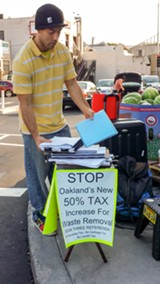 COURTESY OF PAMELA DRAKE - A paid petition gatherer in Oakland used a sign with false statements to get voters to sign the petition.