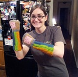 A RedditGifts participant shows off her new knitted arm-warmers.