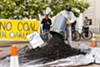 "Activists dump ""coal"" in Oakland."