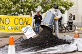 "STEVE NADEL - Activists dump ""coal"" in Oakland."