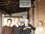 Adam Lamoreaux (second from right) outside Linden Street Brewery.