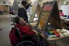 Adrienne Olmedo, who has cerebral palsy, said painting makes her calm.