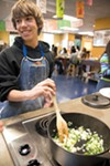 After growing their food, students also learn how to prepare it and cook it.