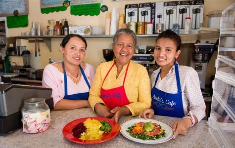 Anula Edirisinche (center) inside her tiny restaurant, Anula's Cafe. - CHRIS DUFFEY