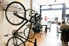Arbor cafe features wall-mounted racks in addition to a bike pump and repair stand.