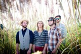 Ash Reiter (center) and her band.