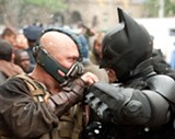 Batman (Christian Bale) faces Bane (Tom Hardy) in The Dark Knight Rises.