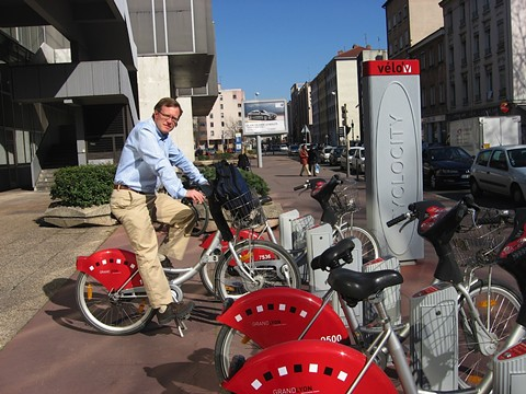 Matt Nichols, Oakland's new transportation policy director, trying a bike share program overseas. - COURTESY OF MATT NICHOLS