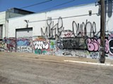 COURTESY OF WAYNE MCNEIL - Before volunteers stepped in, Wayne McNeil's building was covered in graffiti.