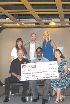 Ben Wanzo, holding check, won Retail Star.