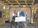 Ben Wanzo, holding check, won Retail Star.