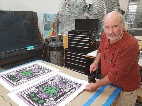 Master screen-printer, Thomas Wojak, finishes up a limited batch of posters commemorating BPG's 15 years of service. - BPG (VIA FACEBOOK)