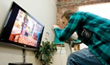 """ALI THANAWALLA - """"Brett"""" powers the TV by riding the exercise bike at the Activist Gym in West Oakland."""