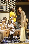 Cal women's basketball coach Joanne Boyle tutors some players during a recent practice.