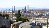 MAYA SUGARMAN/FILE PHOTO - CalPERS owns $1.75 billion in stock in ExxonMobil and Chevron, including its Richmond refinery.