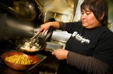 CHRIS DUFFEY - Charleen Caabay cooks up garlic noodles with shrimp.