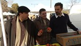 COURTESY THE COOKING CHANNEL - Charlie Hallowell (right) shops at the farmers' market.