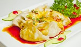 China Village's dumplings with house-made spicy sauce.