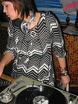 "Christine Tocalino DJs at ""Bottom Feeder."""