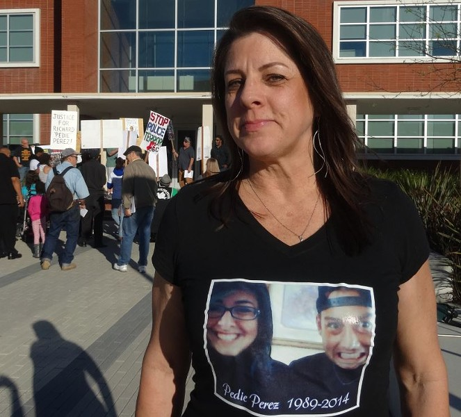 Richard Perez's aunt Rhonda Perez outside Richmond City Hall on March 17, 2015. - DARWIN BONDGRAHAM