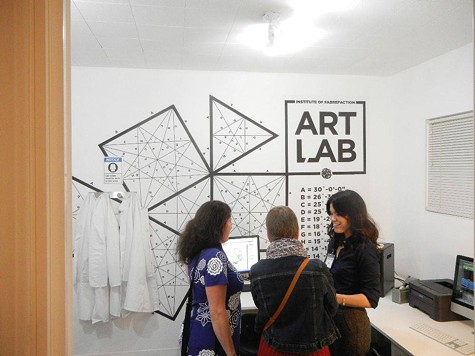Co-Director Lena Reynoso (right) with opening night attendees in the Art Lab