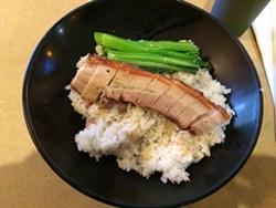The roast pig lunch bowl at Cafe 88. - LUKE TSAI
