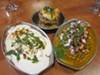 Dahi vada (far left), one of the most delicious yet hard to find chaat items, is available at Chaat House.