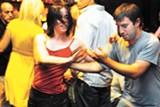 MAYA SUGARMAN - Dancers heat up the dance floor at Swig (above). Ed Ivey leads the jam session (below).