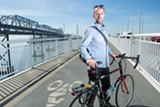 """PHOTO BY BERT JOHNSON - Dave Campbell, advocacy director of Bike East Bay, said that """"we're not going to make Oakland better by giving more space to cars."""""""
