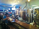 ELLEN CUSHING - Elevation 66's row of brew tanks.